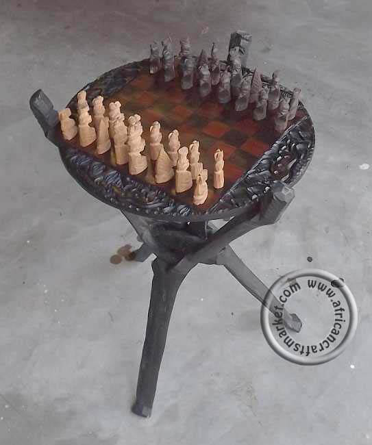 African handcrafted wooden chess set on table