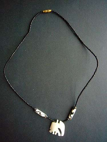 African bone mask necklace