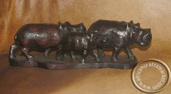 African wooden hippo family