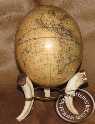 Ostrich egg on Warthog tusk stand