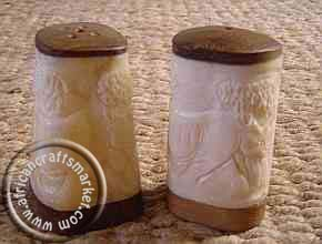 African carved bone salt and pepper shakers Box