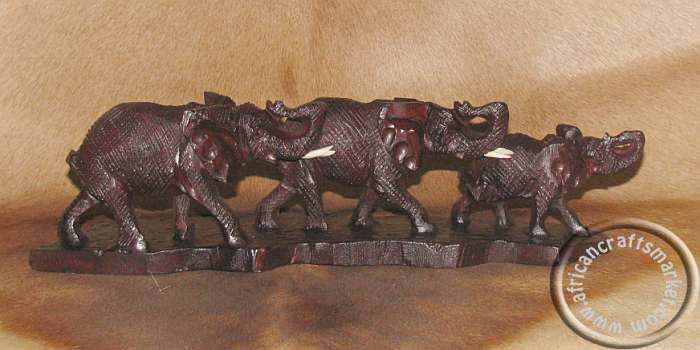 African wooden elephant family